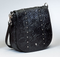 Designer tooling and appointments give this concealed carry purse a stylish look