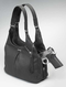Concealed carry compartment is embedded in center of handbag for easy weapon access