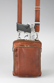 Tanned leather over-the-shoulder concealed carry handbag for excellent self-protection.