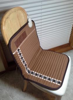 mini-biomat-in-chair.png