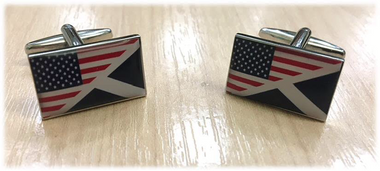 The flags of The USA and Scotland combined on a cufflink.