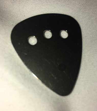"""Some of you wanted a perfectly flat solid metal pick that won't wear.  For those who demand total consistency over time and who believe flexibility and """"breaking in"""" are functions that lie beyond the start of ones sound, we introduce TITANIUM!  May it provide a sense of permanence in our rapidly changing world!"""
