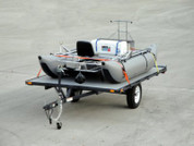 The versamax raft trailer shown loaded with a raft (not included).