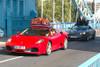 Ferrari carrying luggage on top