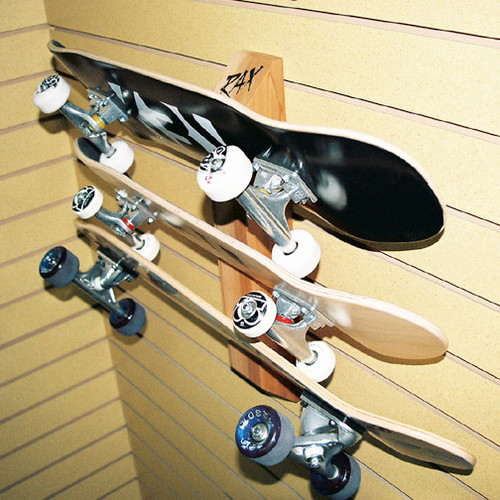 Three skateboard display and storage rack