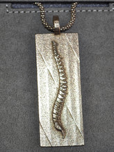 Can be worn as a pendant