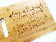 A house is built with Boards & Beams Cutting Board