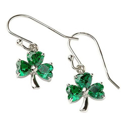 """Description Let your originality show with this enchanting pair of shamrock earrings. The piece features three glowing retro green stones with a sterling silver base. Atop of the shamrock connects a shining sterling silver earring hook looped through a hoop on the shamrock in a distinct manner.   The Luck of the Irish  A shamrock is a cherished symbol in Celtic tradition. The shamrock has been revered due to it being a three leaf plant, and the ancient Celtic druids had a very religious approach to objects in a triad. Occasionally, a shamrock is found with four leaves. These are rare and considered to bring great luck to the finder in respect, love, health, and abundance. The shamrock is said to bring mystical powers such as healing of venomous bites and serve as warnings to approaching storms. The shamrock is associated with Ireland more than any other symbol.  To Be In Clover A common Irish saying is """"to be in clover"""", or to live a carefree life of ease and prosperity. Wearing a shamrock is a very tribunal act to the Irish tradition. Not only does it bring positive energy into your life in terms of wealth, abundance, health, and love, but it also undoes the malevolent magic of a leprechaun."""