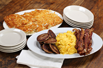 Wake up everyone at your meeting or event with a delicious hot breakfast! Enjoy fresh scrambled eggs, golden hash browns, your choice of breakfast meat and your favorite toast. Don't forget orange juice and coffee!