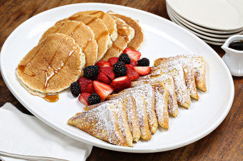 There's nothing like a hearty breakfast to start the day! Everyone at your party or event will love fluffy pancakes or French Toast, topped with strawberries and sprinkled with powdered sugar. Remember to order fresh squeezed orange juice and coffee too!