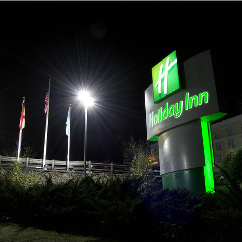Holiday Inn - LED lighting illuminating the flags in front the hotel