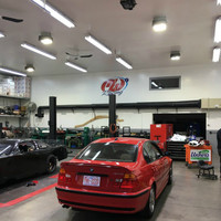 LED ShoeBay light fixtures mounted inside the auto shop of Mike Wallace