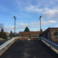 Front of the salt brine facility with square straight steel anchor base light poles and 80w LED Shoebox light fixtures