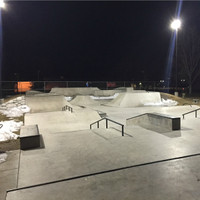 Square straight steel light poles with LED Shoebox light fixtures illuminating the Riverton Skate park.