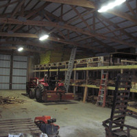 Inside the lumber warehouse with LED Low Bay light fixtures.