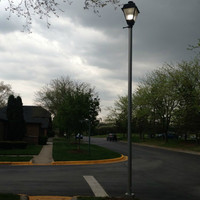 Replacement aluminum anchor base light pole installed at the walkway