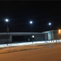 25' round tapered steel light poles installed in the parking lot