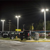 240w & 160w LED Shoebox light fixtures mounted on 20' square straight steel light poles illuminating the front lines