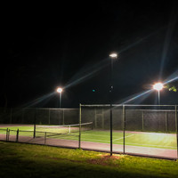 20' direct burial aluminum light poles with 240w 4000K Shoebox light fixtures for a tennis court project in Princeton, New Jersey.