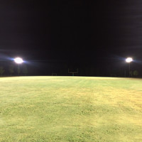 LED Sports lights and steel light poles installed on the football field