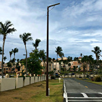 Round tapered fiberglass light poles installed for roadways in Puerto Rico