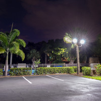 Condo parking lot LED lighting package - 12' fiberglass light poles, 40w LED Shoebox light fixtures, and 4 @ 90deg aluminum bullhorn brackets.