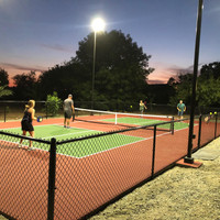 LED Shoebox light fixtures and square straight steel light poles for backyard pickleball court in California.