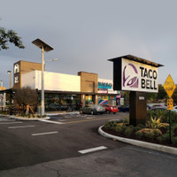 Taco Bell parking lot uses steel brackets from LPP for mounting fixtures on to concrete light poles.
