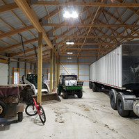 LED Ecobay light fixtures with suspension mounts inside the shed for Fjord Trucking.