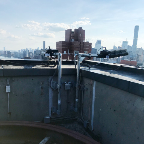NEW 470w High-Output LED Helios light fixtures and custom brackets installed for downlighting on building in New York.