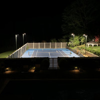 Hunter green direct burial light poles and area light fixtures used for backyard tennis court LED lighting project in New York