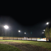 30' Square Straight Smooth Fiberglass light poles, 2@180deg. bullhorn brackets, and 240w LED Shoebox light fixtures installed for equestrian application