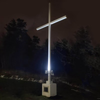 Unique custom project utilizing aluminum light pole and arms for religious cross