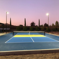 Backyard pickleball application in California using 160w LED Shoebox light fixtures and round straight aluminum light poles