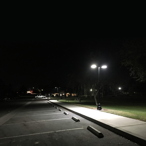 Light poles and LED lighting for parking lot and walkway lighting application