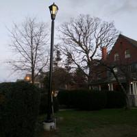 Decorative LED light fixture with aluminum pole for facility entrance