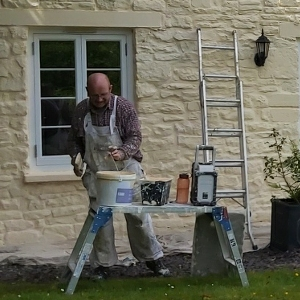 Painting exterior walls with permeable paint