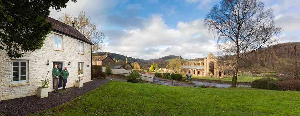F and M at Tintern Abbey Cottage with abbey panorama