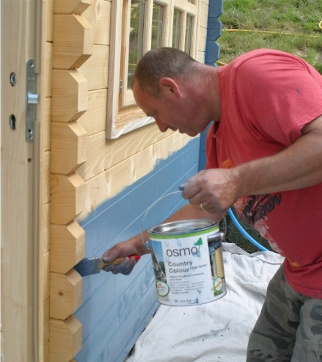 The Cwtch Summer Houses painted with Blue Outdoor Wood Paint