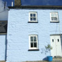 Farmhouse painted with Earthborn Silicate Masonry Paint (Colour: Cobalt Blue).