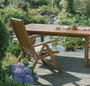 Osmo Decking Oil - Teak Clear finish (007) on wooden garden furniture.