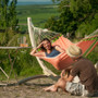 "Mango Spreader bar Hammock from La Siesta suspended from the ""Canoa"" Wooden Hammock Stand."