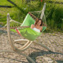 "Kiwi Spreader bar Hammock from La Siesta suspended from the ""Canoa"" Wooden Hammock Stand."