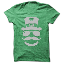 Leprechaun T-Shirt in Green with Silver Sparkle Logo on Front. Shines in the sun. Great For Teachers.