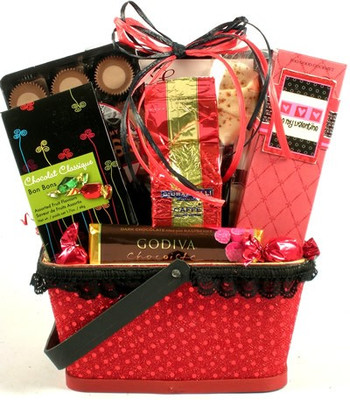 Red gift basket with cookies, coffee, valentine's cookies, fruit candy and chocolates.