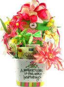A planter filled with gifts of chocolates, cookies and truffles for mom.