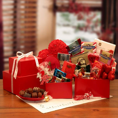 Two Red Boxed Stacked and filled with Chocolates.