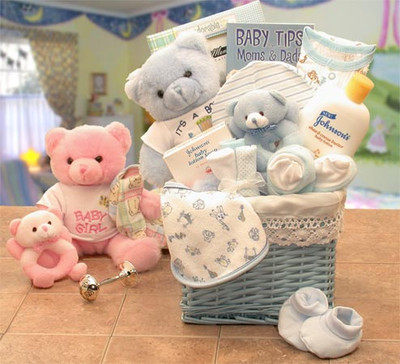 Fabric lined basket filled with a plush teddy, rattle, bath wash, wash cloth, picture frame and more.