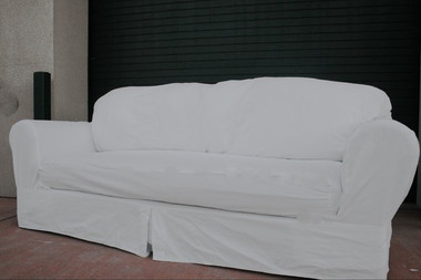 Actual slipcovered ugly sofa. This is what they look like, no catalog magic here.