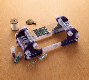 Clover Beading Loom.  Weave wonderful accessories with this easy-to-use loom.  Create everything from accessories to embellishments.